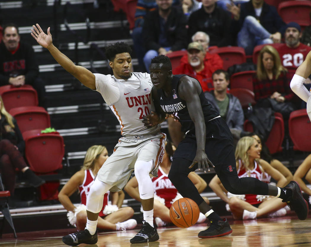 San Diego State Aztecs forward Aguek Arop (3) drives the ball against UNLV Rebels forward Nick Blair (20) during the second half of a basketball game at the Thomas & Mack Center in Las Vegas o ...