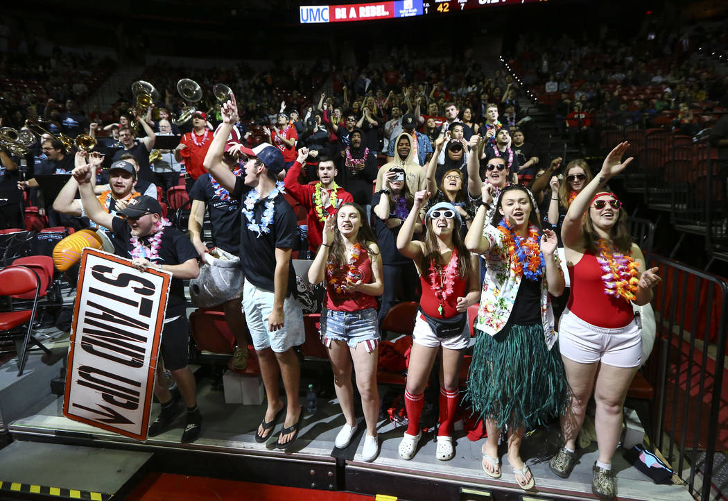 UNLV Rebels fans in the student section cheer during the second half of a basketball game against San Diego State at the Thomas & Mack Center in Las Vegas on Saturday, Feb. 23, 2019. (Chase St ...