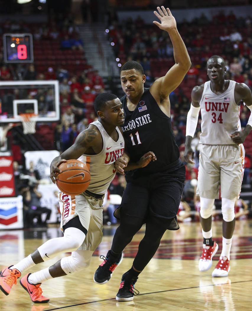 UNLV Rebels guard Amauri Hardy (3) drives the ball against San Diego State Aztecs forward Matt Mitchell (11) during the second half of a basketball game at the Thomas & Mack Center in Las Vega ...