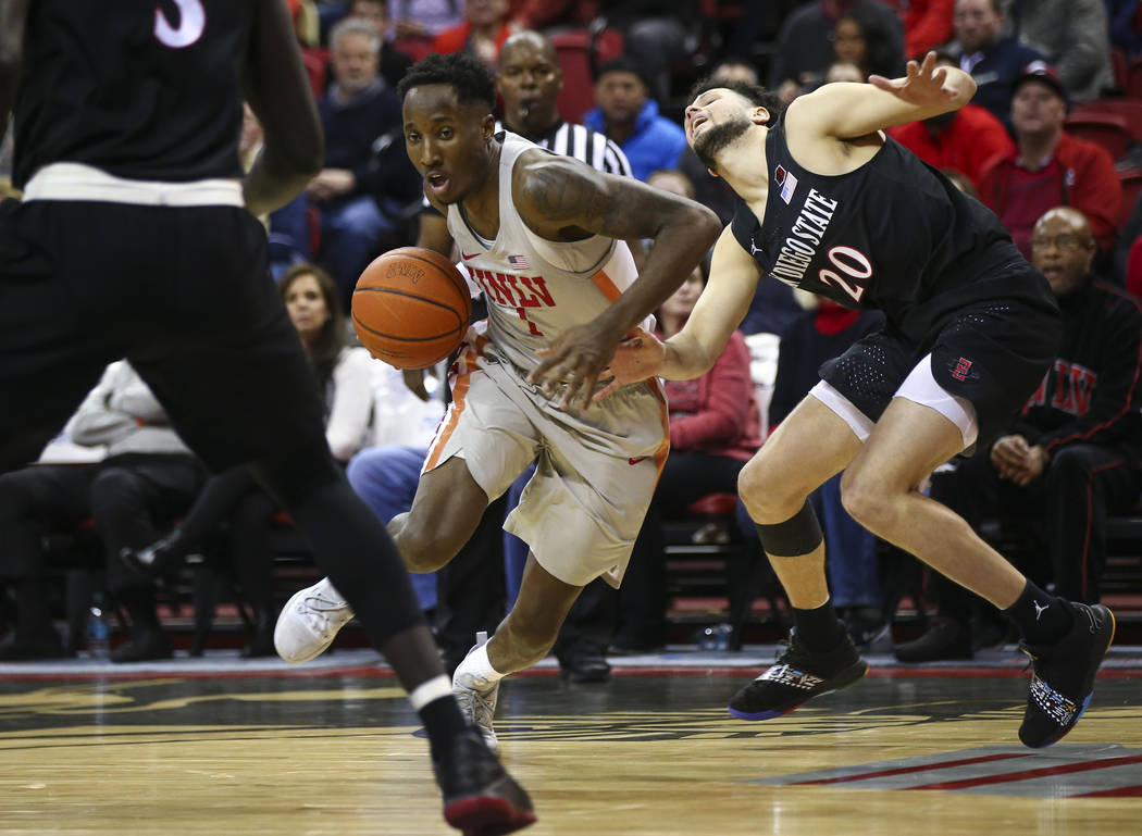 UNLV Rebels guard Kris Clyburn (1) drives past San Diego State Aztecs guard Jordan Schakel (20) during the second half of a basketball game at the Thomas & Mack Center in Las Vegas on Saturday ...