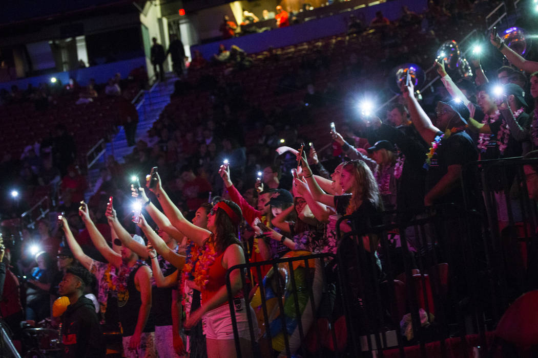 UNLV Rebels fans in the student section shine lights before the start of a basketball game against San Diego State at the Thomas & Mack Center in Las Vegas on Saturday, Feb. 23, 2019. (Chase S ...
