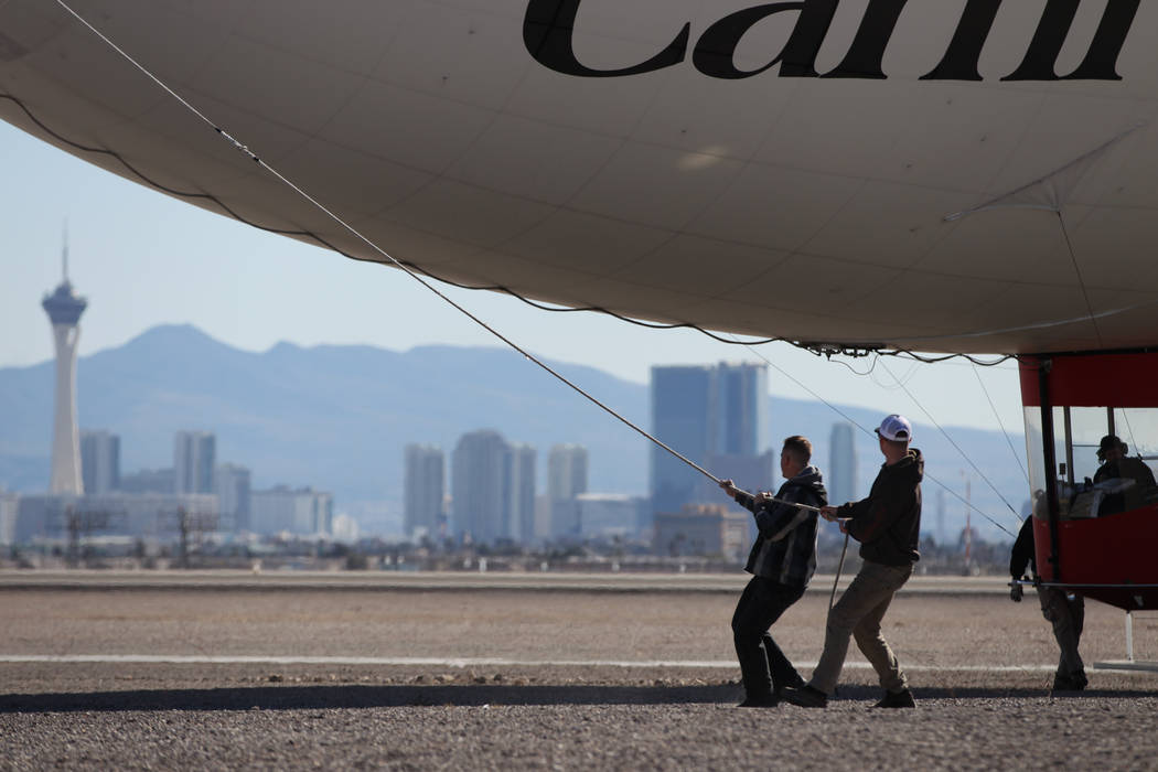 Crew members guide an AirSign Airship blimp for take off from the North Las Vegas Airport in North Las Vegas, Thursday, Feb. 7, 2019. The blimp was advertising the Carnival Cruise Line's new Carn ...