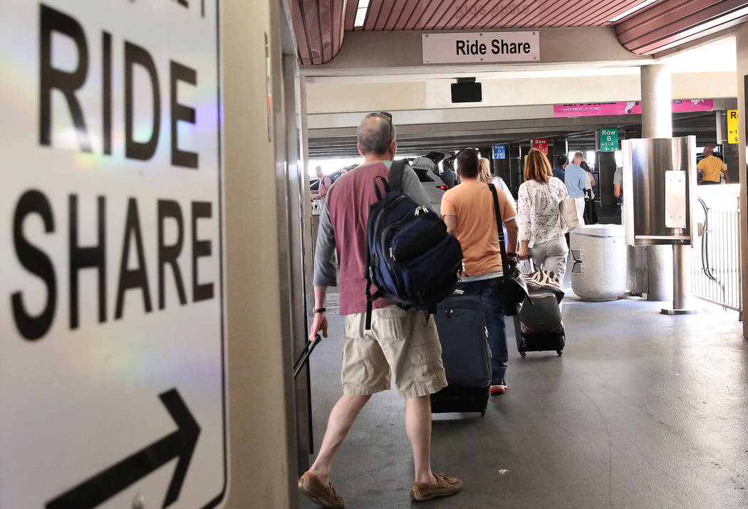 Riders arrive at Ride-hailing companies' Uber and Lyft pick up area at McCarran International Airport at Terminal 1 on Thursday, June 1, 2017, in Las Vegas. Bizuayehu Tesfaye Las Vegas Review-Jour ...