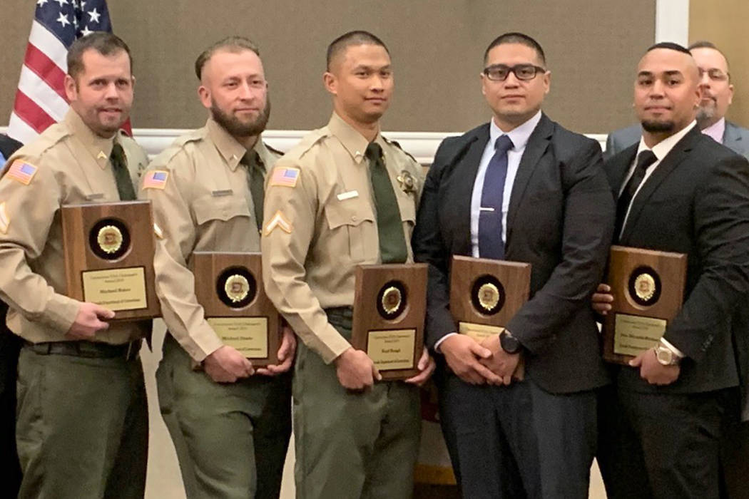Michael Baker, from left, Michael Dante, Neal Bengil, Michael Dacken and Jose Miranda stand with their Chairman Awards from CorrectionsUSA at an awards ceremony on February 6, 2019, at Harrah's in ...