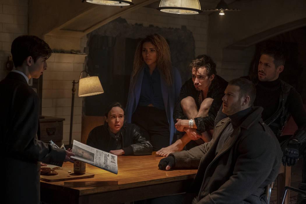 "From left, Aidan Gallagher, Ellen Page, Emmy Raver-Lampman, Robert Sheehan, Tom Hopper and David Castaneda star in ""The Umbrella Academy."" (Christos Kalohoridis/Netflix)"