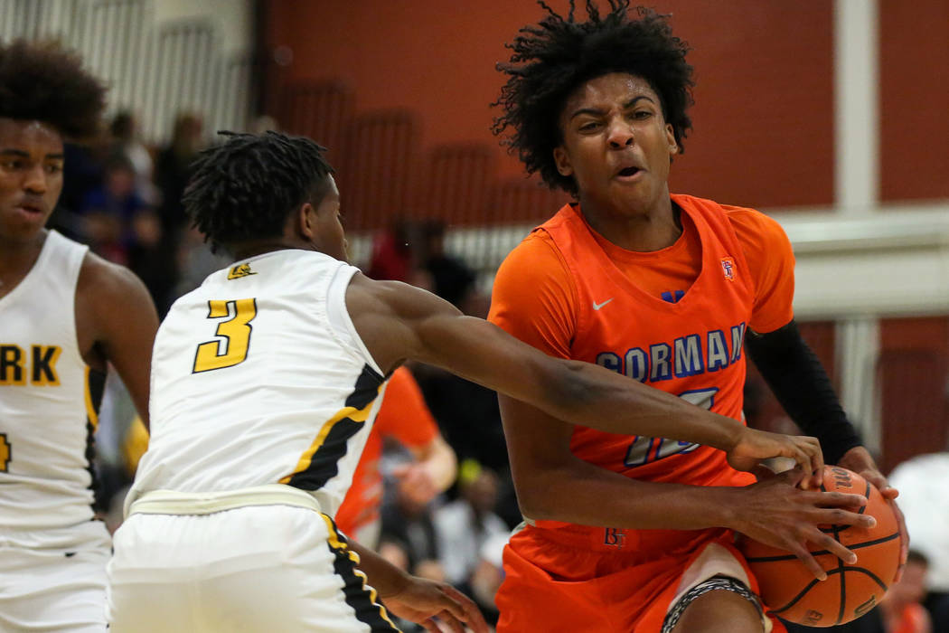 Clark's Joel Burney (3) reaches for the ball as Bishop Gorman's Zaon Collins (10) dribbles down the court during a basketball game at Clark High School in Las Vegas, Thursday, Feb. 7, 2019. Caroli ...
