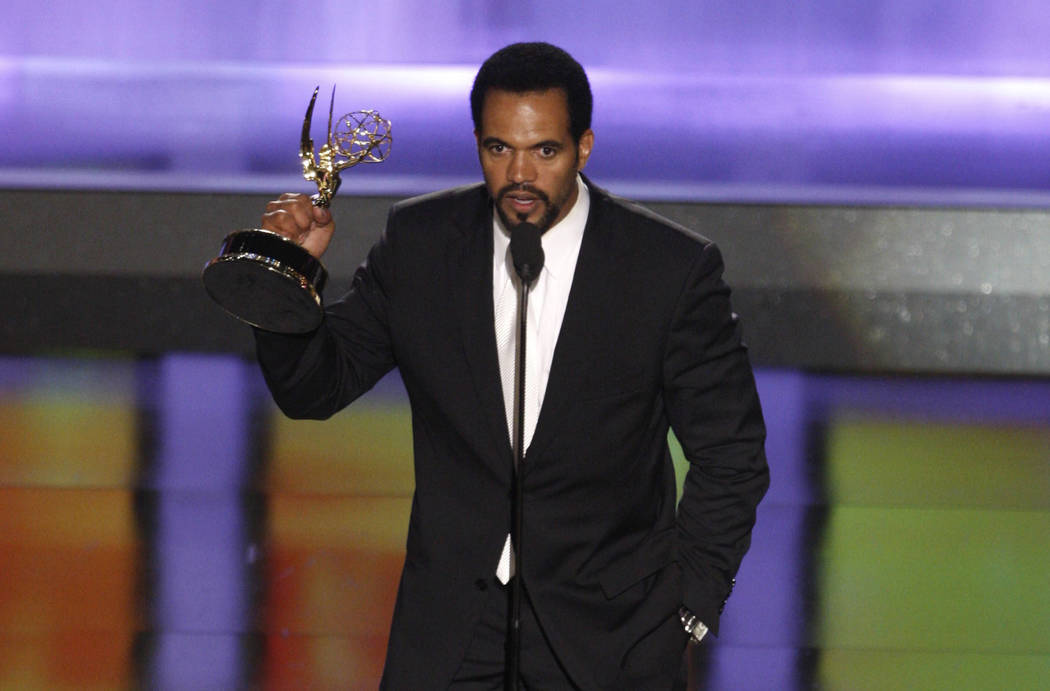 """Kristoff St. John accepts the award for outstanding supporting actor in a drama series for his work on """"The Young and the Restless"""" at the 35th Annual Daytime Emmy Awards in Los Angeles on June 20 ..."""