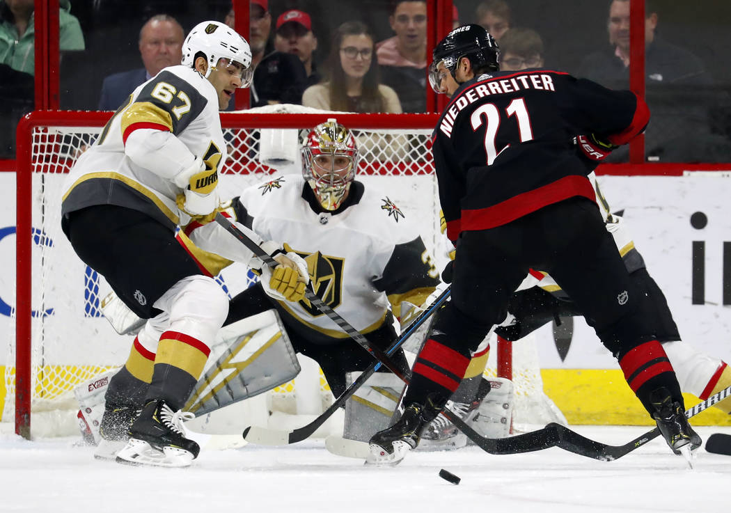 Vegas Golden Knights goaltender Maxime Lagace (33) blocks the shot of Carolina Hurricanes' Nino Niederreiter (21) with Golden Knights' Max Pacioretty (67) nearby during the second period of an NHL ...