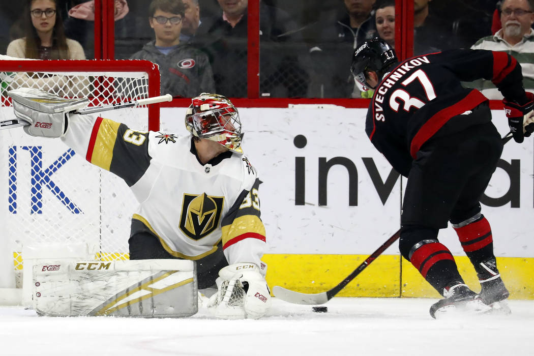 Vegas Golden Knights goaltender Maxime Lagace (33) blocks the shot of Carolina Hurricanes' Andrei Svechnikov (37) during the second period of an NHL hockey game Friday, Feb. 1, 2019, in Raleigh, N ...