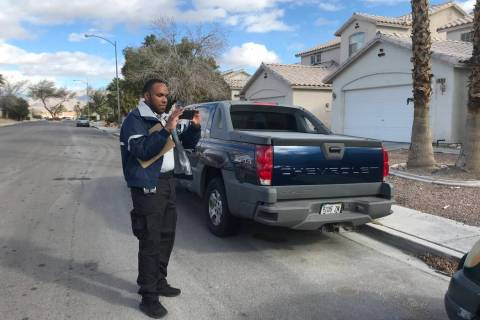 Anthony Coleman, a parking enforcement officer with the City of North Las Vegas, observes what seems to be an abandoned vehicle in a residential area at the northwest end of the city. (Mia Sims/ L ...