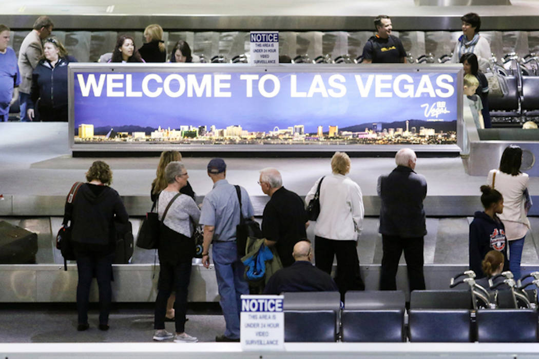 People wait to retrieve luggage at McCarran International Airport (Ronda Churchill/Las Vegas Review-Journal)