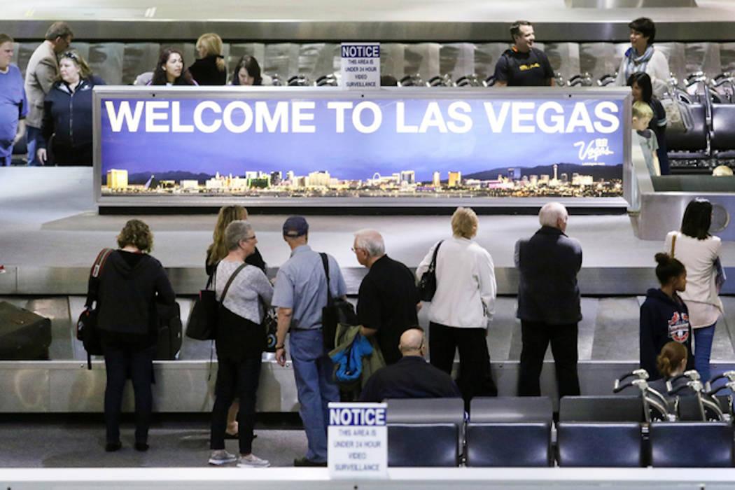People wait to retrieve luggage at McCarran International Airport (Ronda Churchill/Las Vegas Review-Journal)
