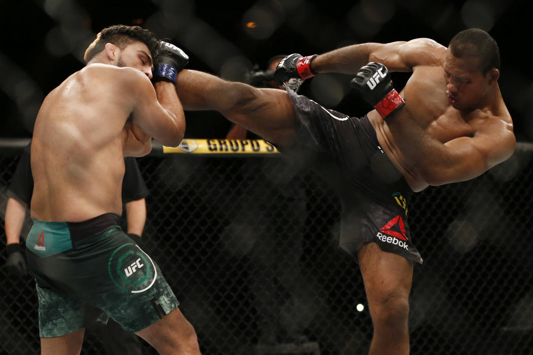 Ronaldo Souza, right, from Brazil, kicks Kelvin Gastelum, from the United States, during their UFC middleweight mixed martial arts bout in Rio de Janeiro, Brazil, early Sunday, May 13, 2018. (AP P ...