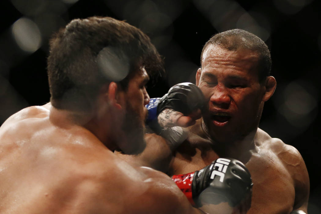 Ronaldo Souza, right, from Brazil, fights Kelvin Gastelum, from the United States, during their UFC middleweight mixed martial arts bout in Rio de Janeiro, Brazil, early Sunday, May 13, 2018. (AP ...