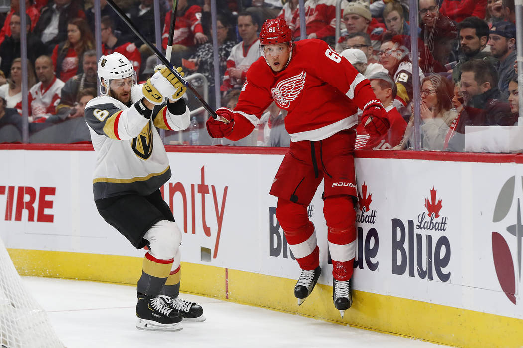 Vegas Golden Knights defenseman Colin Miller (6) checks Detroit Red Wings center Jacob de la Rose (61) into the boards in the second period of an NHL hockey game Thursday, Feb. 7, 2019, in Detroit ...
