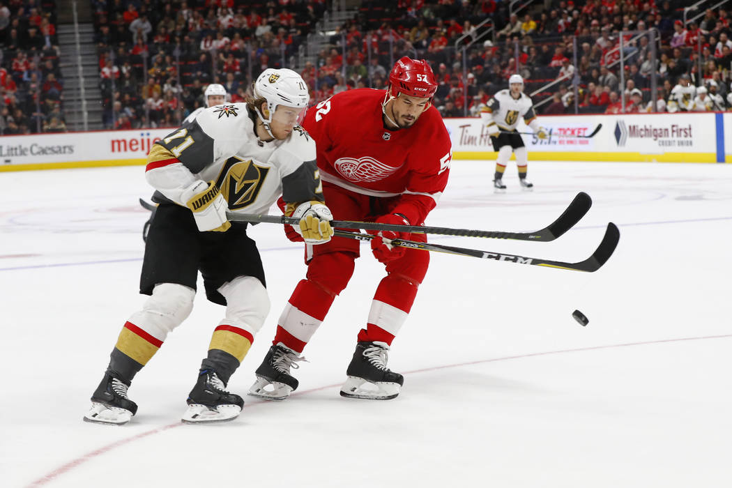 Vegas Golden Knights center William Karlsson (71) flips the puck past Detroit Red Wings defenseman Jonathan Ericsson (52) in the third period of an NHL hockey game Thursday, Feb. 7, 2019, in Detro ...