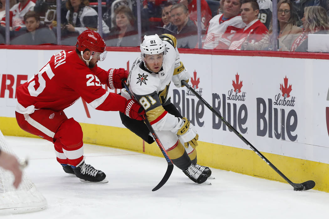 Vegas Golden Knights center Jonathan Marchessault (81) protects the puck from Detroit Red Wings defenseman Mike Green (25) in the third period of an NHL hockey game Thursday, Feb. 7, 2019, in Detr ...