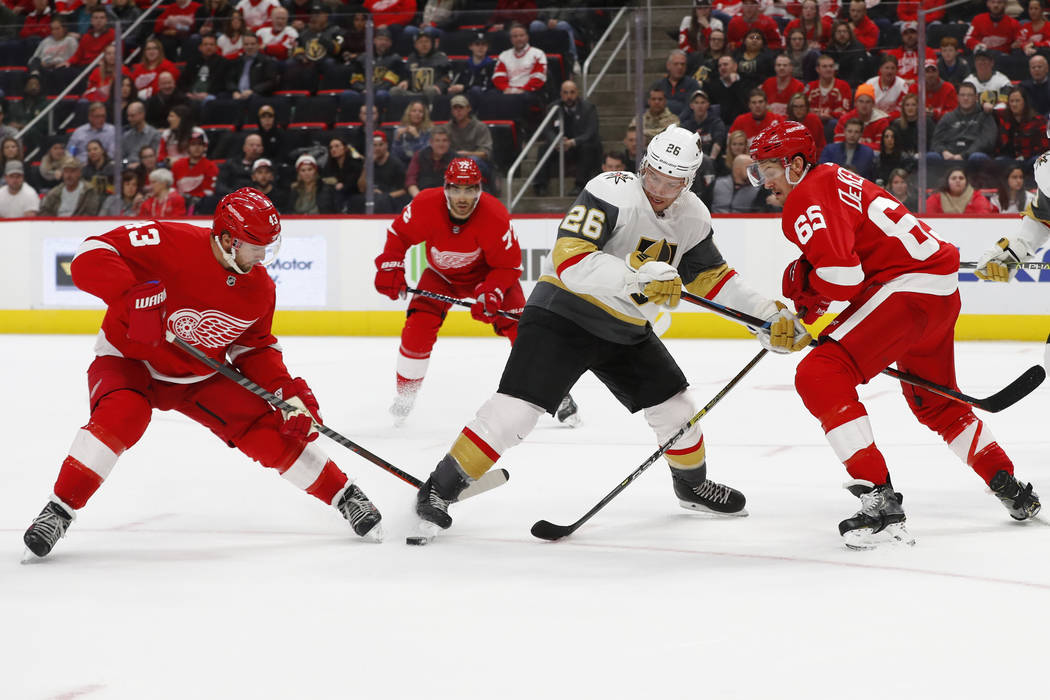Vegas Golden Knights center Paul Stastny (26) tries to keep the puck from Detroit Red Wings left wing Darren Helm (43) and Danny DeKeyser (65) in the third period of an NHL hockey game Thursday, F ...