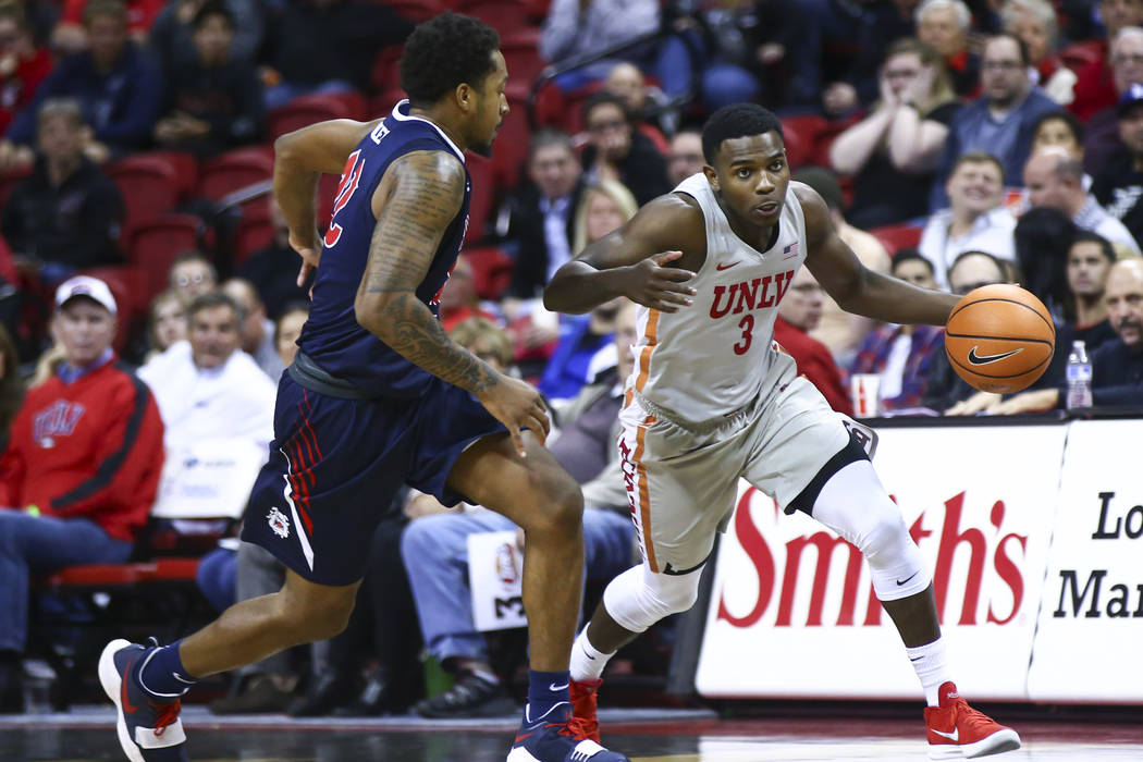 UNLV Rebels guard Amauri Hardy (3) drives against Fresno State Bulldogs guard Ray Bowles Jr. (22) during the second half of a basketball game at the Thomas & Mack Center in Las Vegas on Wednes ...