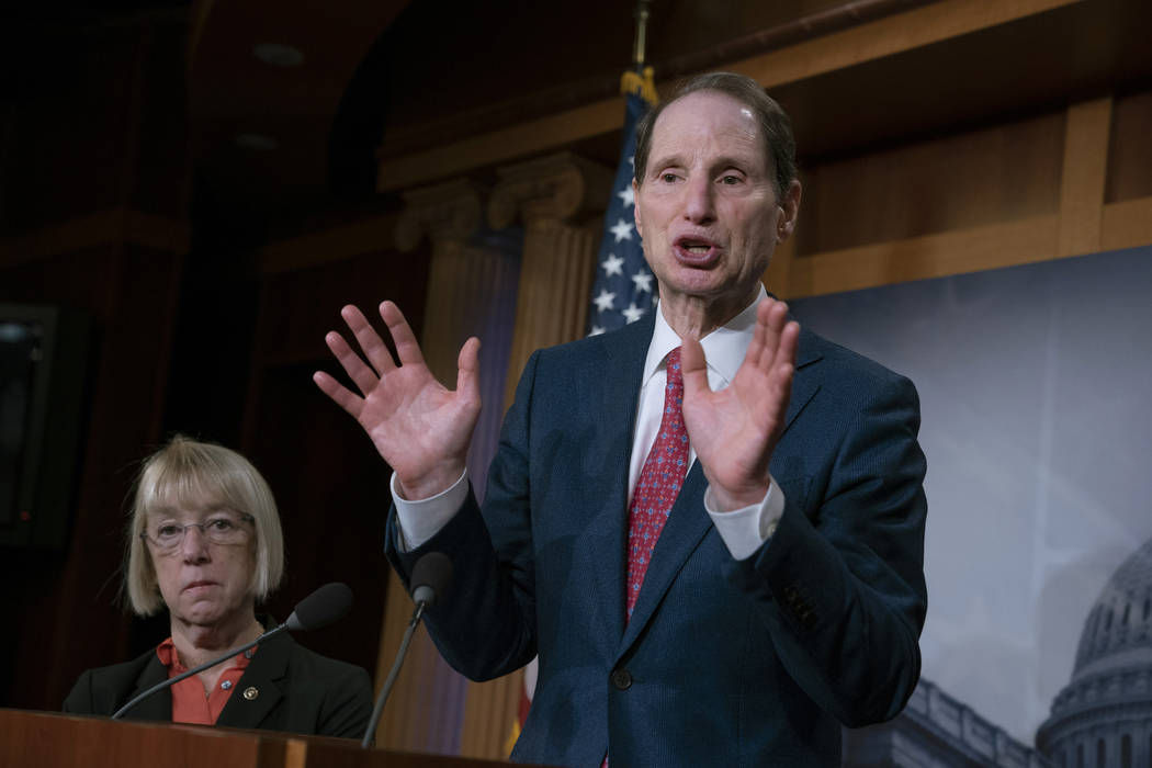 Sen. Ron Wyden, D-Ore., joined at left by Sen. Patty Murray, D-Ore., speaks during a news conference in December 2018 on Capitol Hill in Washington. (AP Photo/J. Scott Applewhite)