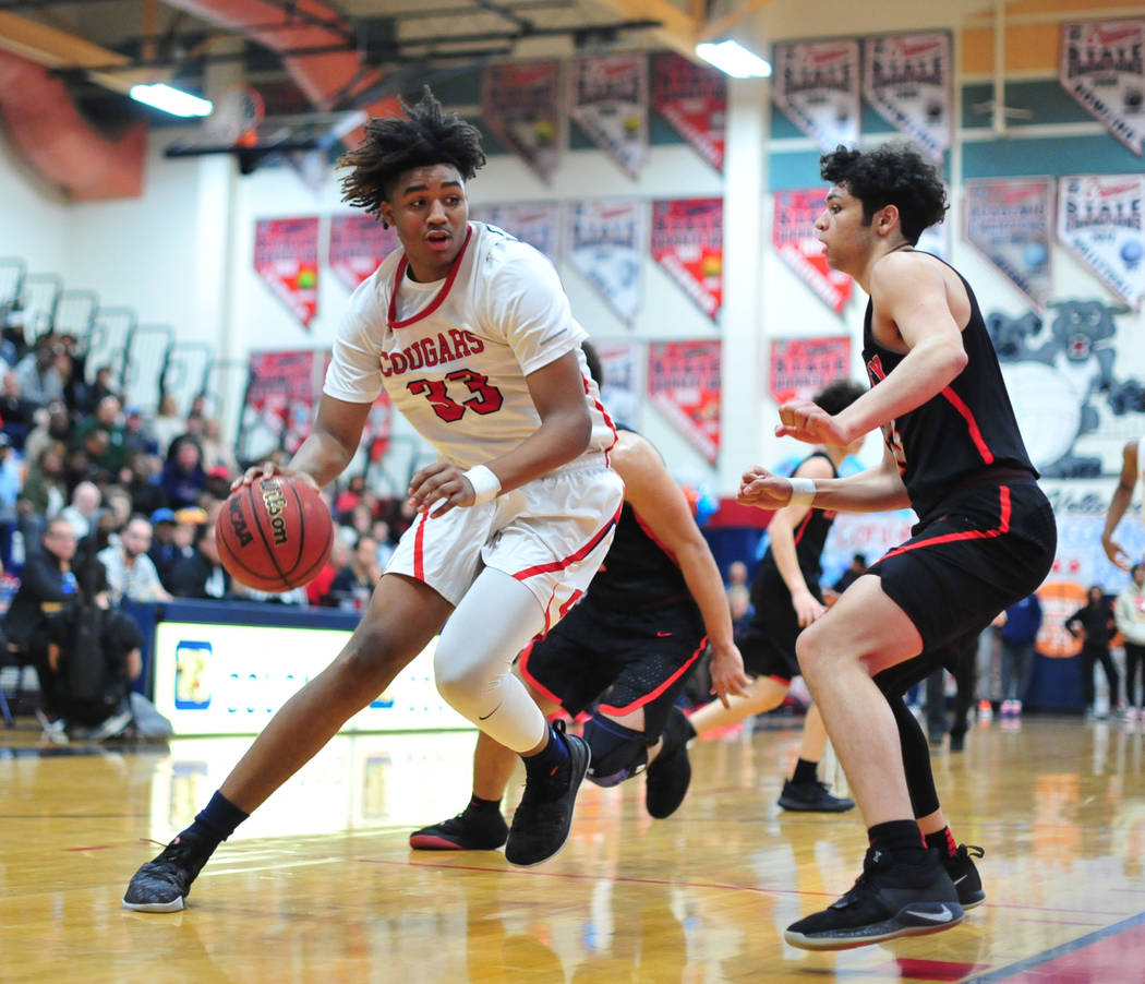 Coronado's Jhaylon Martinez (33) dribbles the ball toward the basket in the second quarter of a game between Coronado High School and Liberty High School at Coronado High School in Henderson, Nev. ...
