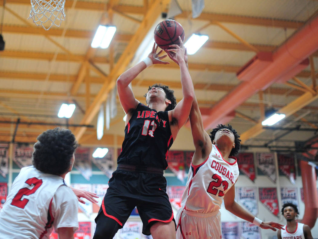 Coronado's Ra'shon Martinez (23) tips a shot away from Liberty's Terrance Marigney (13) in the third quarter of a game between Coronado High School and Liberty High School at Coronado High School ...