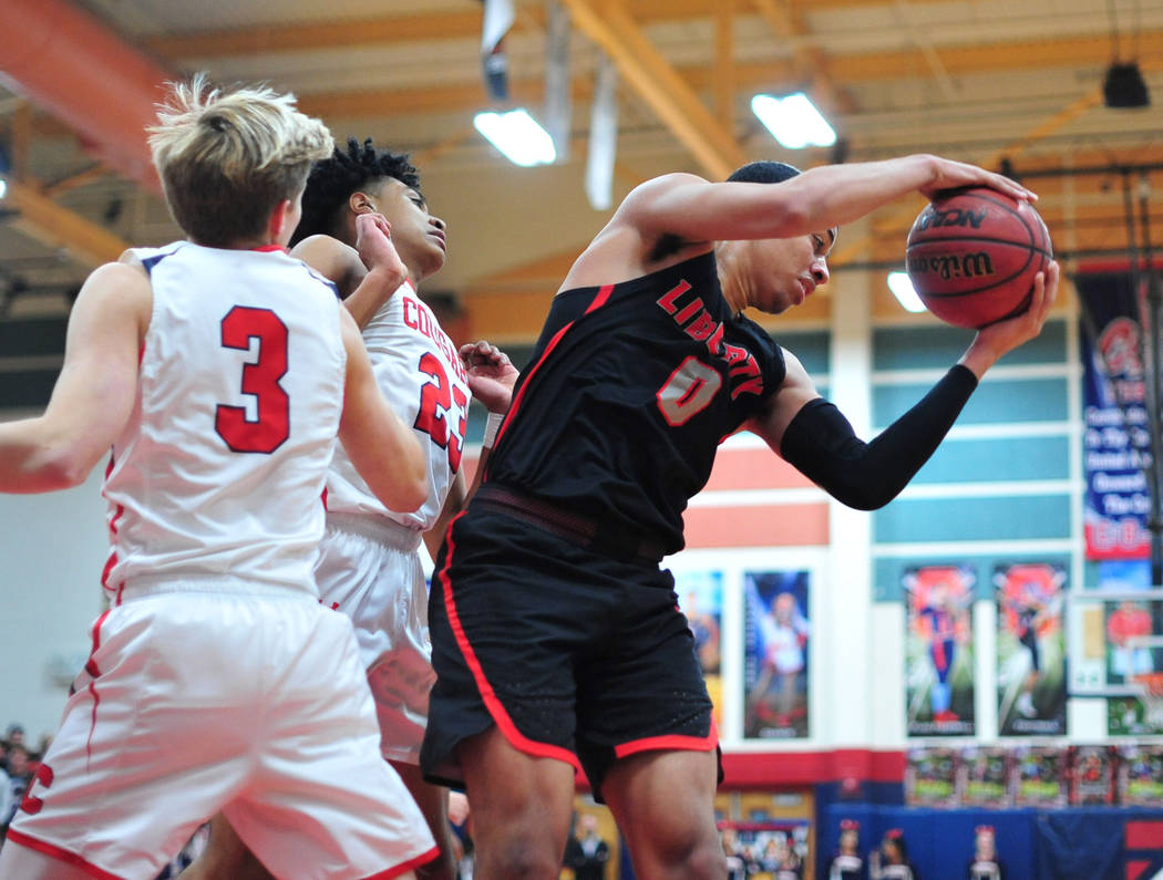 Liberty's Julian Strawther (0) pulls down a rebound in the third quarter of a game between Coronado High School and Liberty High School at Coronado High School in Henderson, Nev., on Friday, Feb. ...