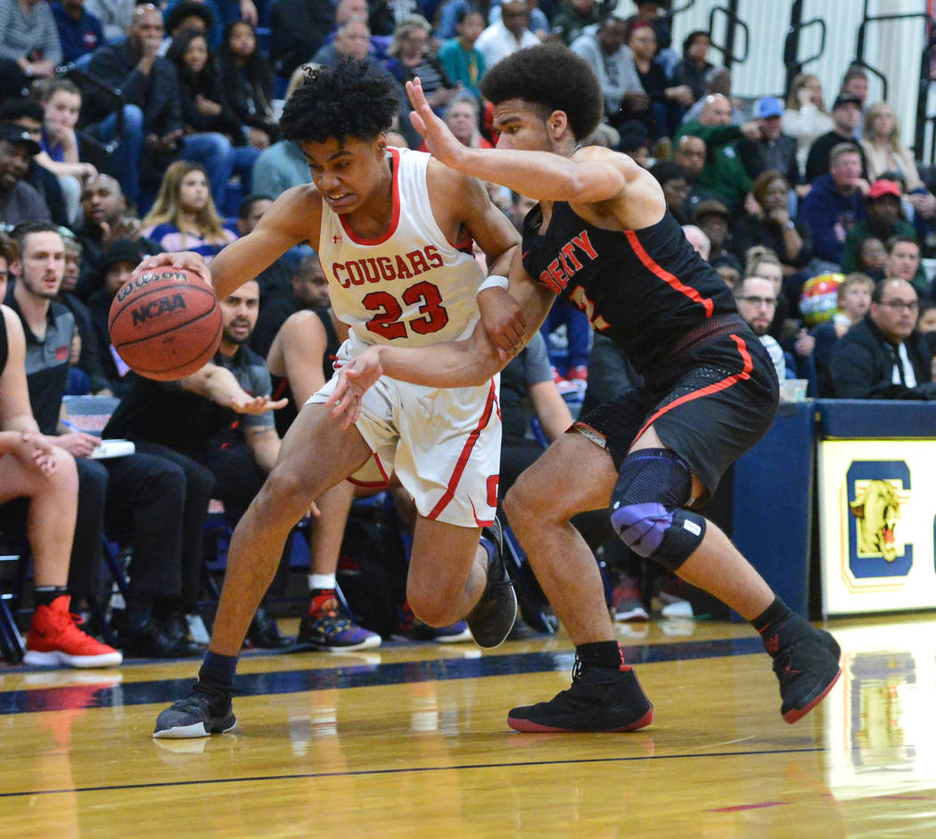Coronado's Ra'shon Martinez (23) dribbles the ball around Liberty's Dante Davis (2) in the fourth quarter of a game between Coronado High School and Liberty High School at Coronado High School in ...