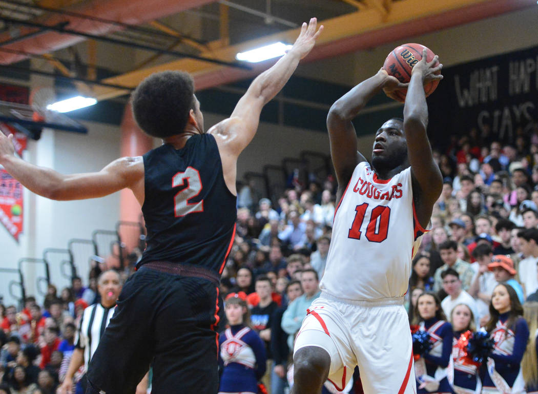 Coronado's Tyrelle Hunt (10) takes a shot over Liberty's Dante Davis (2) during a game between Coronado High School and Liberty High School at Coronado High School in Henderson, Nev., on Friday, F ...