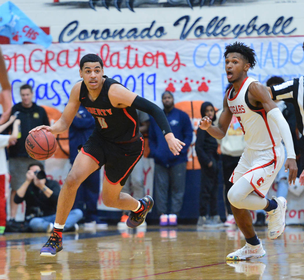 Liberty's Julian Strawther (0) dribbles the ball down court in the third quarter of a game between Coronado High School and Liberty High School at Coronado High School in Henderson, Nev., on Frida ...
