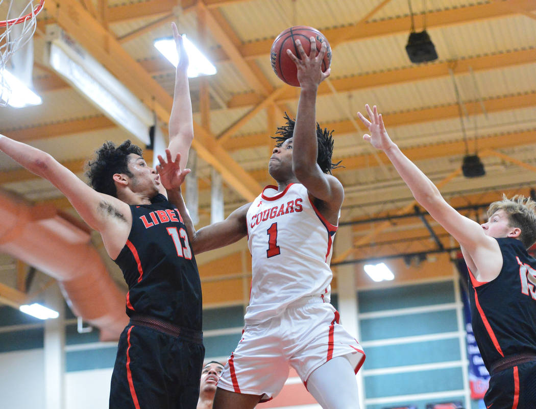 Coronado's Jaden Hardy (1) takes a shot over Liberty's Terrance Marigney (13) in the fourth quarter of a game between Coronado High School and Liberty High School at Coronado High School in Hender ...