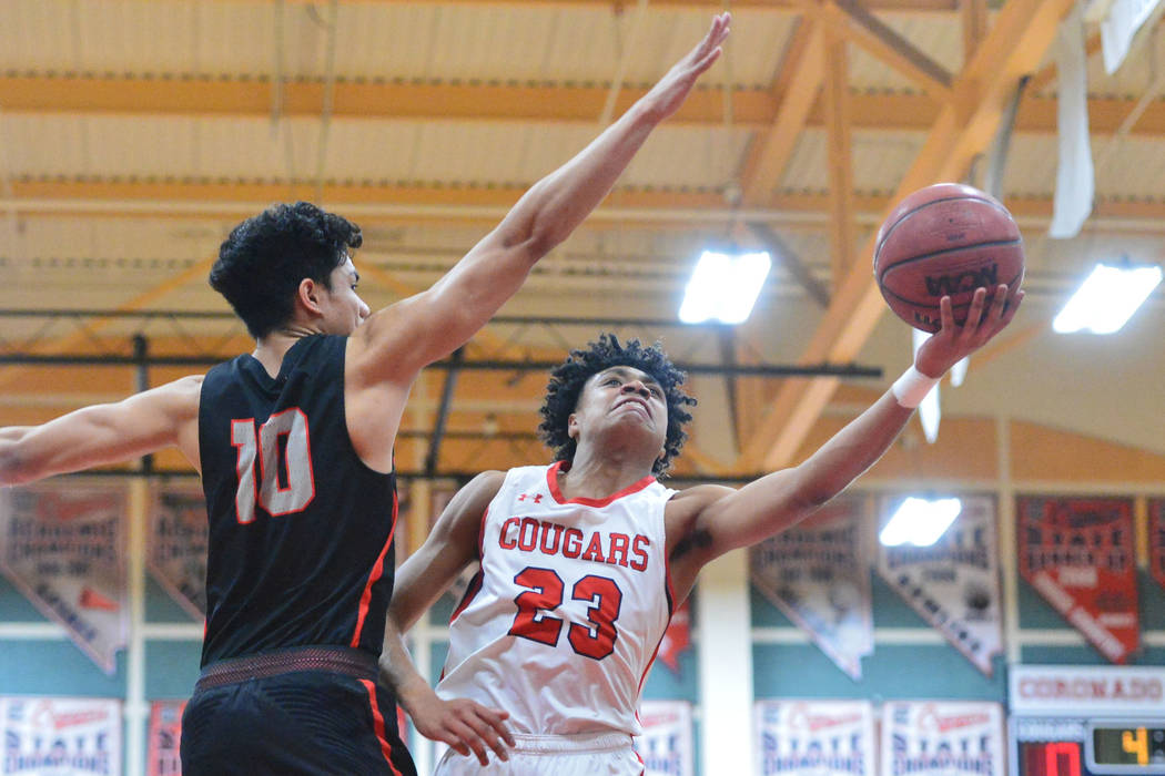 Coronado's Ra'shon Martinez (23) takes a shot past Liberty's Lehi Ausage (10) in the fourth quarter of a game between Coronado High School and Liberty High School at Coronado High School in Hender ...