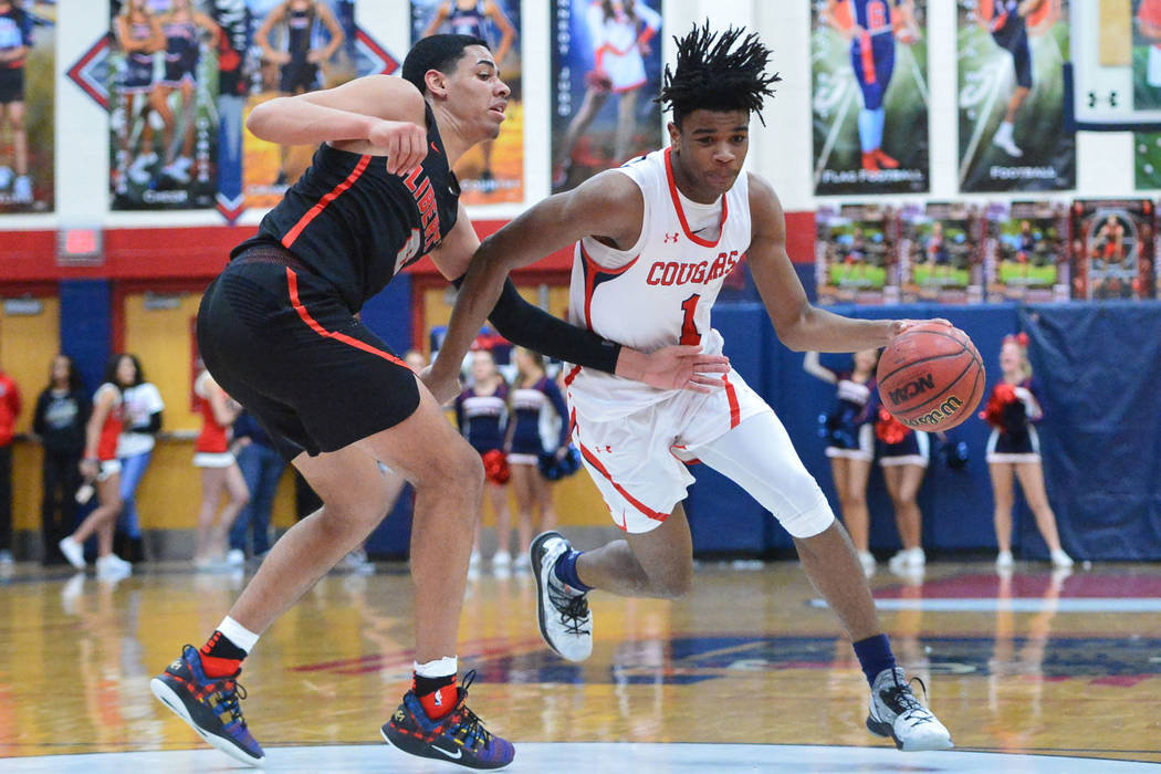 Coronado's Jaden Hardy (1) dribbles the ball past Liberty's Julian Strawther (0) in the fourth quarter of a game between Coronado High School and Liberty High School at Coronado High School in Hen ...