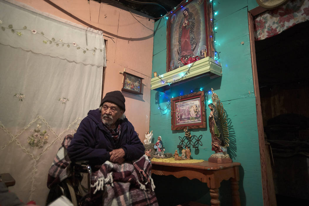 Jose Arias looks on from his home along the border in Tijuana, Mexico, in January 2019. (AP Photo/Gregory Bull)