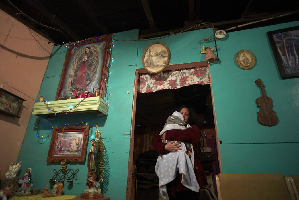 Elsa Leticia Arias holds her baby, Jose, in the family's home along the border in Tijuana, Mexico, in January 2019. (AP Photo/Gregory Bull)