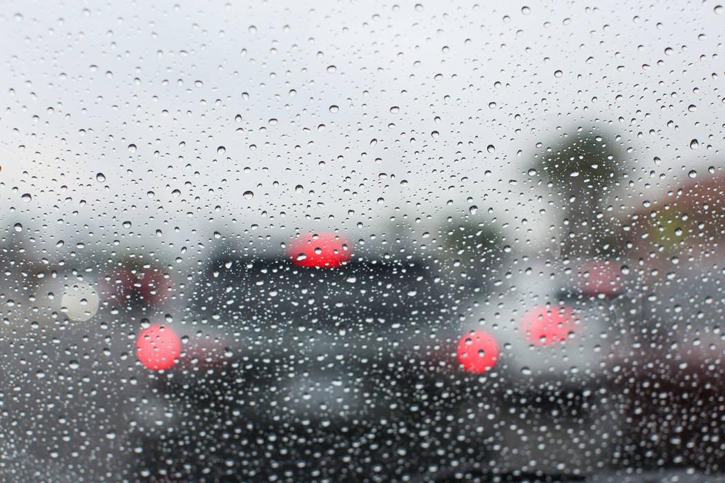 Raindrops gather on a windshield in Las Vegas on Thursday, Aug. 4, 2016. (Brett Le Blanc/Las Vegas Review-Journal)