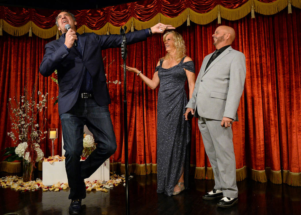Comedian Brad Garrett, left, officiates the wedding of Cyndi Nelson and comedian Rob Sherwood at Brad Garrett's Comedy Club in the MGM Grand hotel-casino in Las Vegas, Saturday, Feb. 9, 2019. Car ...