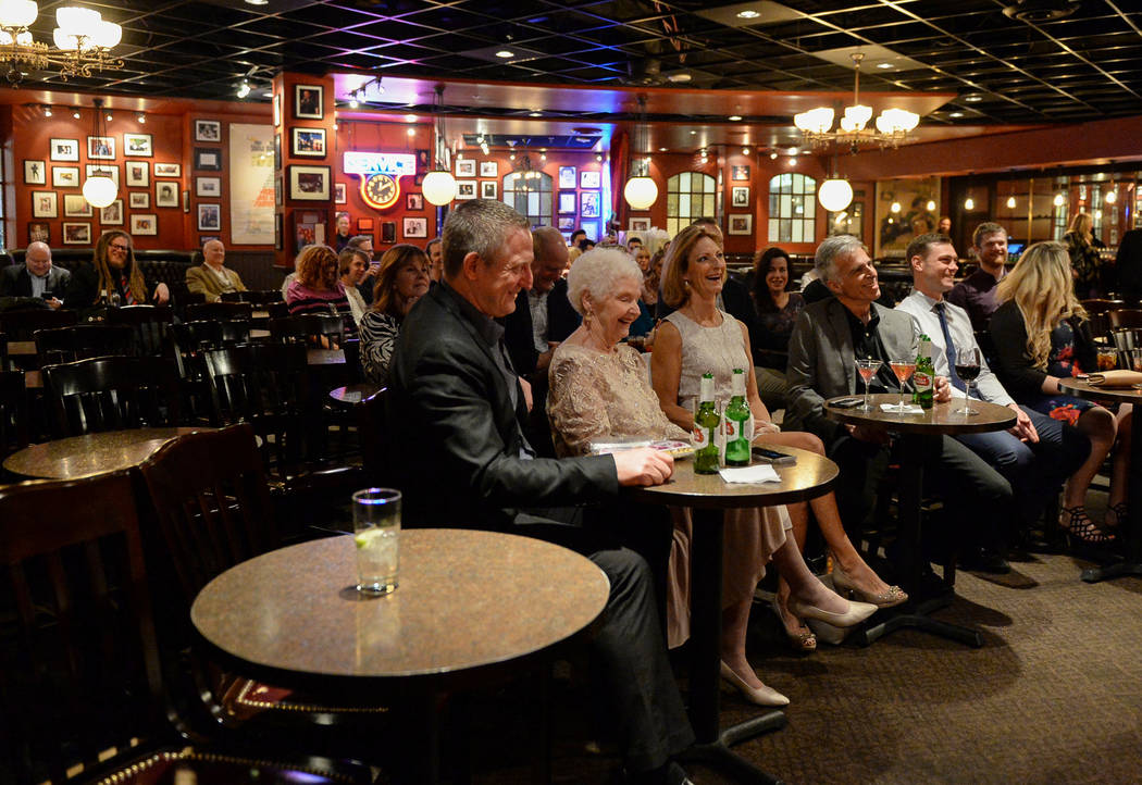Friends and family watch on during the wedding ceremony of Cyndi Nelson and comedian Rob Sherwood at Brad Garrett's Comedy Club in the MGM Grand hotel-casino in Las Vegas, Saturday, Feb. 9, 2019. ...