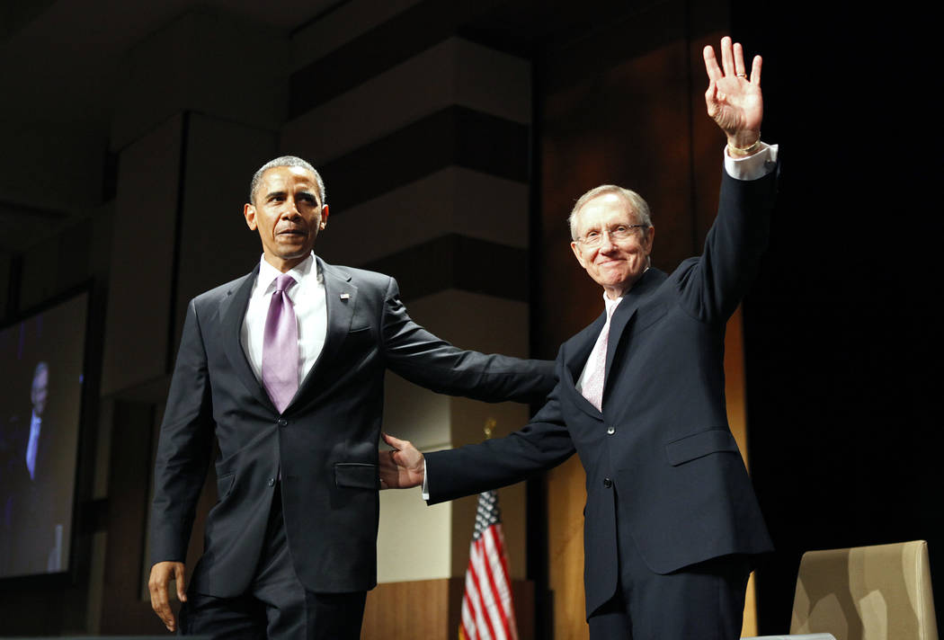 President Barack Obama, left, appears at a rally for Sen. Harry Reid, D-Nev., in Las Vegas, July 8, 2010. (Las Vegas Review-Journal)