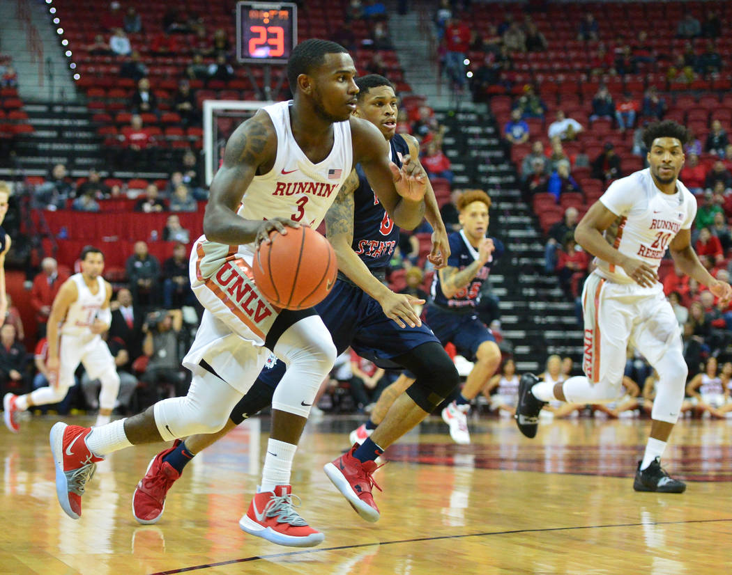 UNLV Rebels guard Amauri Hardy (3) dribbles the ball toward the net during the second half of a game between UNLV and Fresno State at the Thomas & Mack Center in Las Vegas, on Saturday, Feb. 9 ...