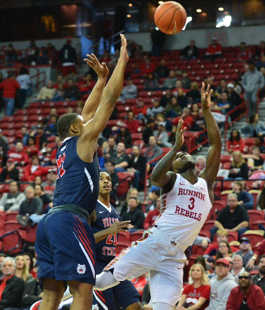 UNLV Rebels guard Amauri Hardy (3) draws a foul while taking a shot during the second half of a game between UNLV and Fresno State at the Thomas & Mack Center in Las Vegas, on Saturday, Feb. 9 ...
