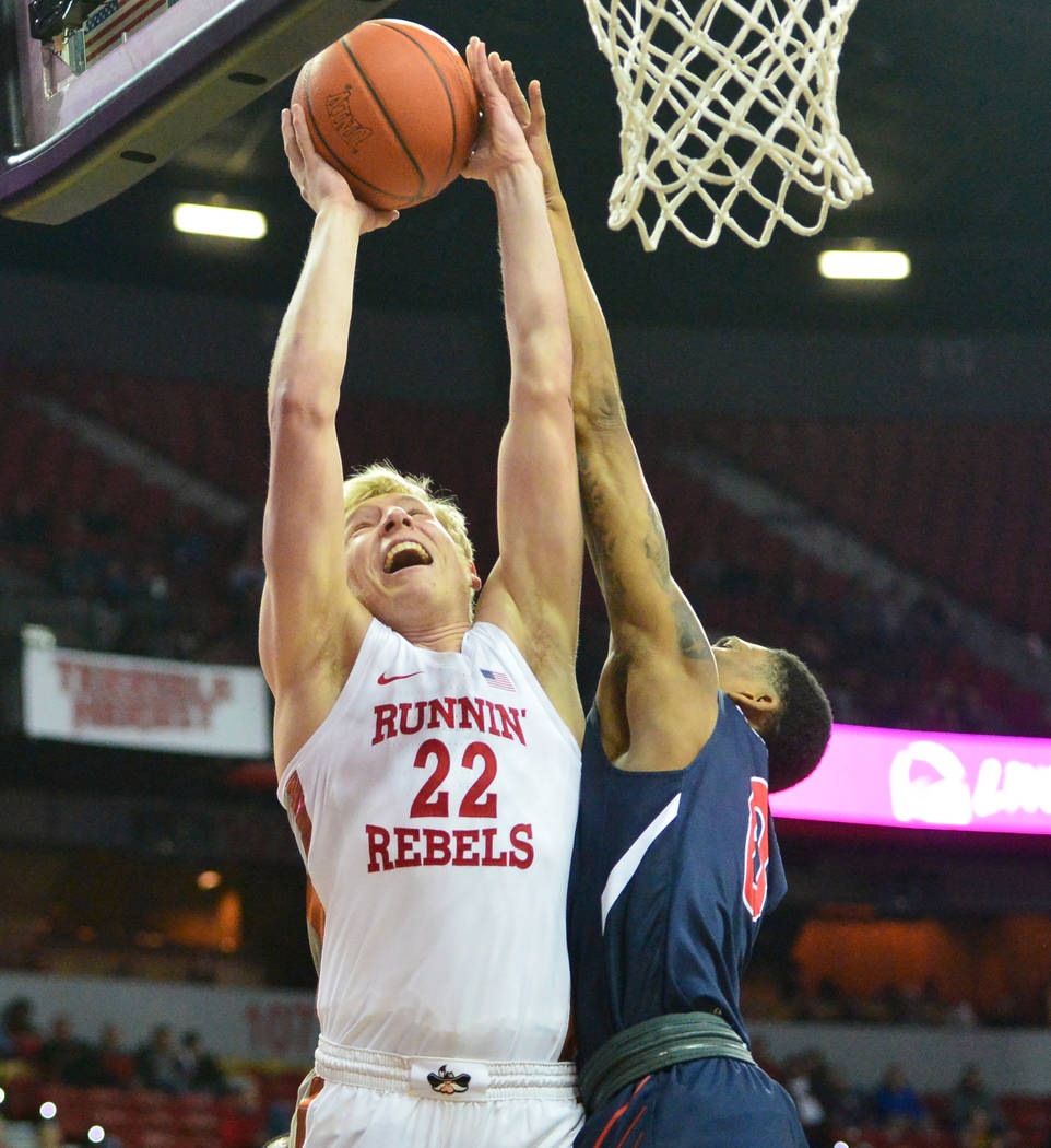 Fresno State Bulldogs guard New Williams (0) fouls UNLV Rebels guard Trey Woodbury (22) during the first half of a game between UNLV and Fresno State at the Thomas & Mack Center in Las Vegas, ...