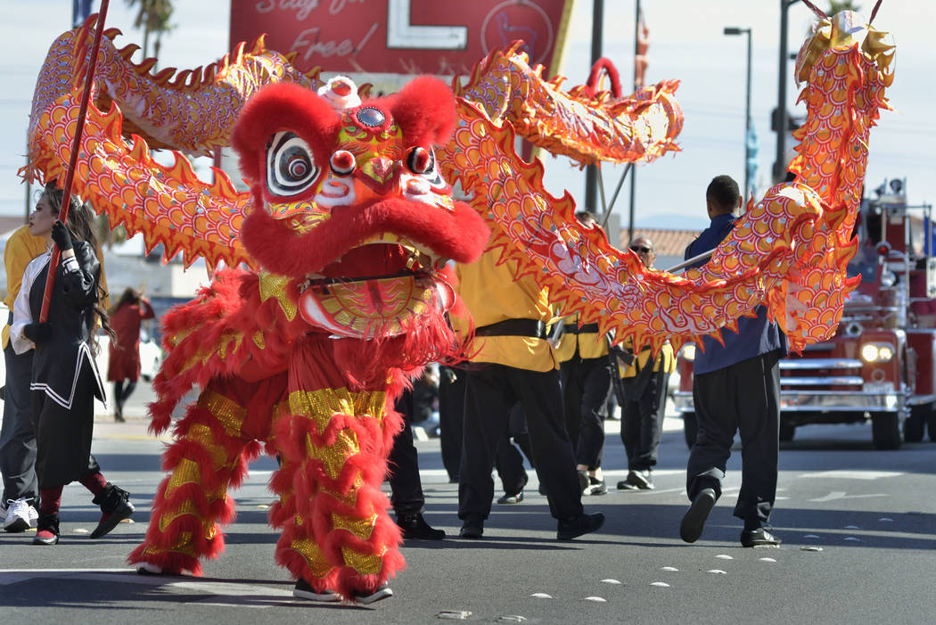Performers from the Lohan School of Shaolin Kung Fu march in a parade during Chinese New Year celebrations on Fremont Street in Las Vegas on Saturday, Feb. 9, 2019. Bill Hughes/Special to the Las ...
