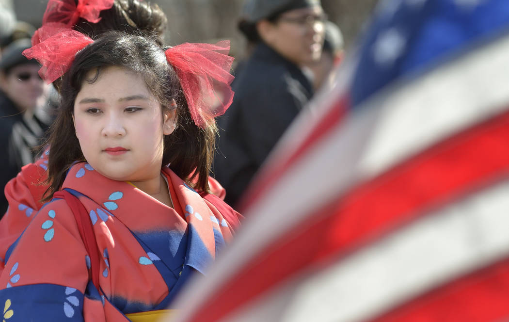 Sophie Ismail, 13, waits for a parade to begin during Chinese New Year celebrations on Fremont Street in Las Vegas on Saturday, Feb. 9, 2019. (Bill Hughes/Las Vegas Review-Journal)