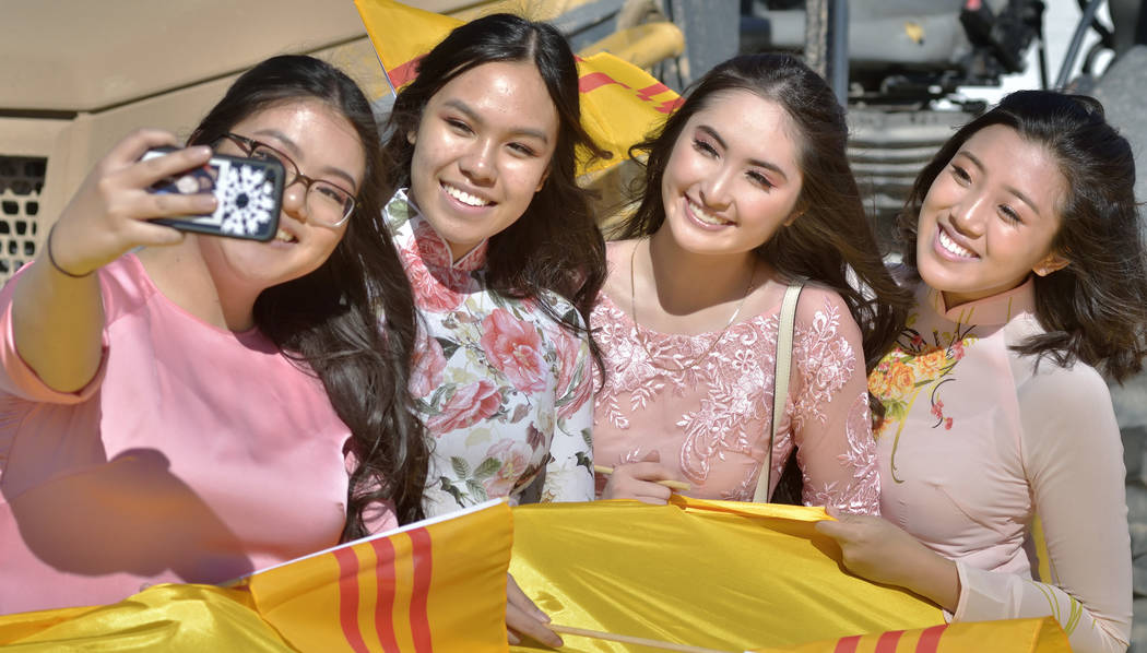 Kim Tran, 17, left, takes a picture with, from left, Kala Nguyen, 17, Jennele Nguyen, 17, and Ariel Nguyen, 17, during Chinese New Year celebrations on Fremont Street in Las Vegas on Saturday, Feb ...