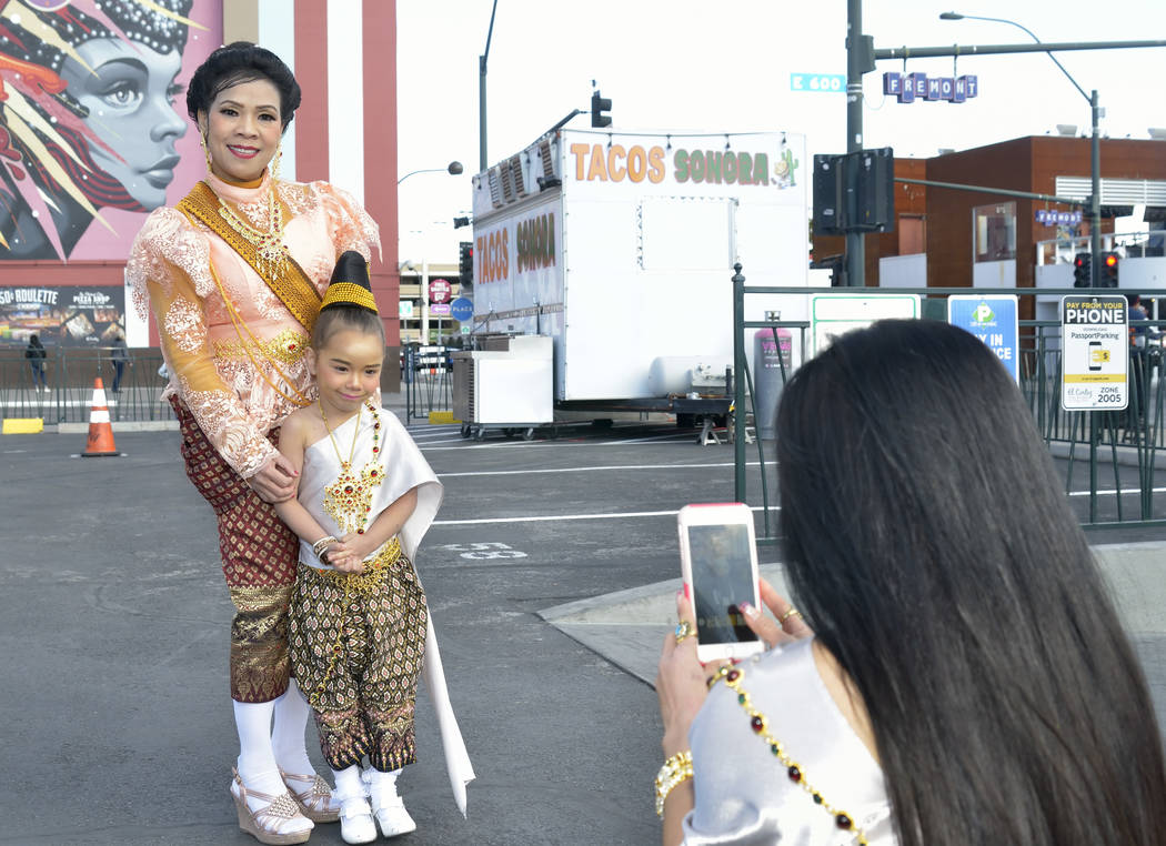 Wicky (cq) Long, right, takes a picture of her daughter Claudia, 5, and Prai Wan during Chinese New Year celebrations on Fremont Street in Las Vegas on Saturday, Feb. 9, 2019. (Bill Hughes/Las Veg ...