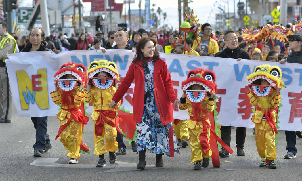Principal Susan Wang, center, leads a group from the New East West Learning Center during a parade which was part of Chinese New Year celebrations on Fremont Street in Las Vegas on Saturday, Feb. ...