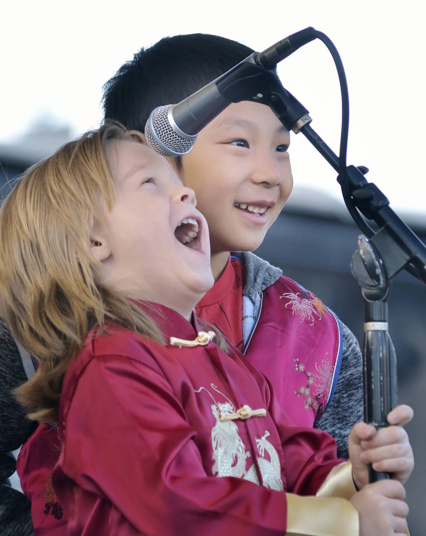 Knox Gray, 4, left, and Sterling Su, 6, perform during Chinese New Year celebrations at the Downtown Container Park at 707 Fremont St. in Las Vegas on Saturday, Feb. 9, 2019. (Bill Hughes/Las Vega ...