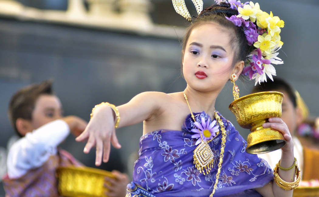 Kanthanut Asana, 8, dances with the Thai Heritage Group of Las Vegas during Chinese New Year celebrations at the Downtown Container Park at 707 Fremont St. in Las Vegas on Saturday, Feb. 9, 2019. ...