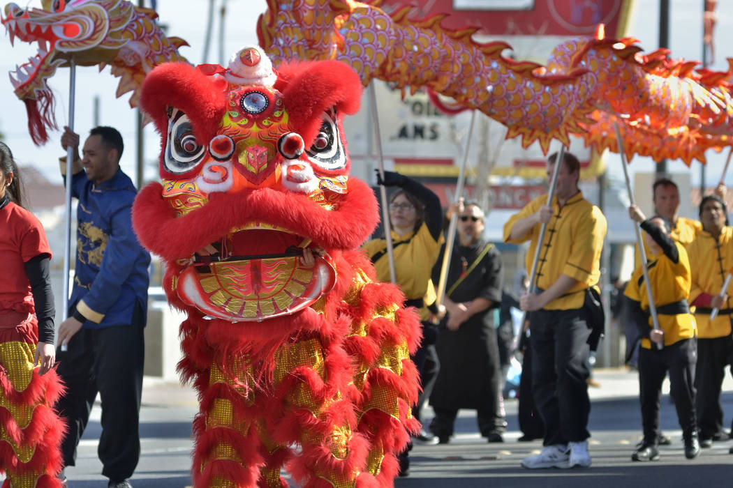 Performers from the Lohan School of Shaolin Kung Fu march in a parade during Chinese New Year celebrations on Fremont Street in Las Vegas on Saturday, Feb. 9, 2019. (Bill Hughes/Las Vegas Review-J ...